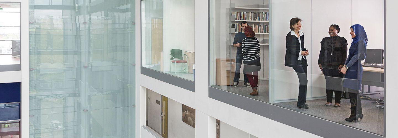 Window view of people inside social sciences building