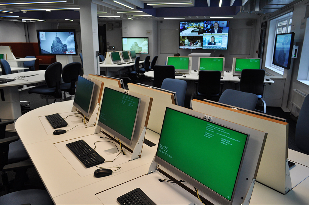 Multimedia suite showing pop up computers in the centre with clear view of all 4 tables