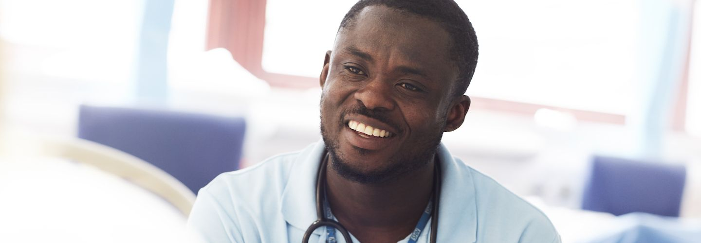 Male health professional smiling