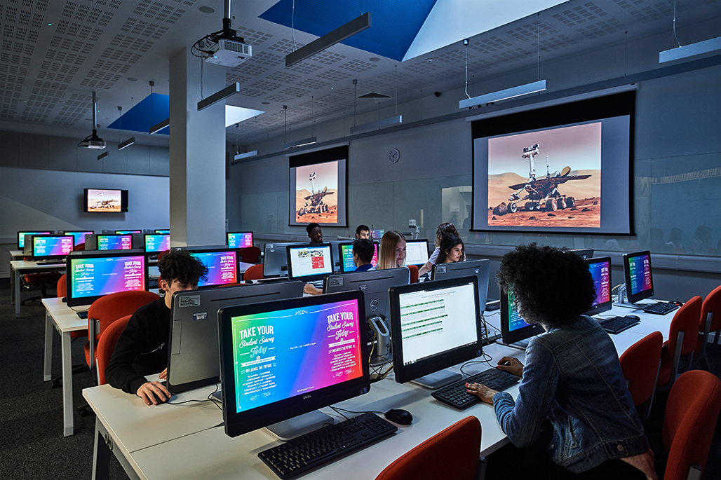 Students attending a class in a computer room