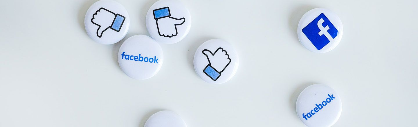 Pin badges with Facebook logos and icons