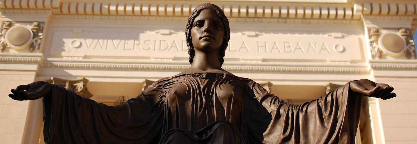 A statue of a woman with arms outspread in front of Havana University
