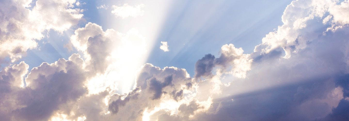 Image of heavenly clouds with rays of sunshine through them