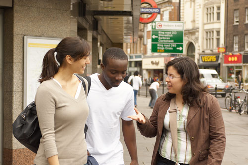 Students talking near Angel station on Upper Street