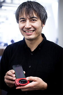 Adrian Cheok with phone