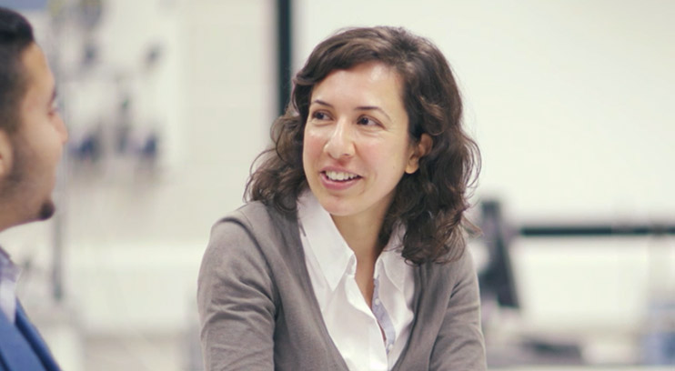 Academic Dr. Joana Fonseca speaking with a student