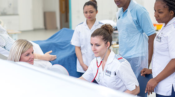 Nursing staff and students simulating practice in City's Clinical Skills Centre