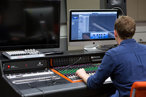 student working in music studio