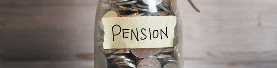 'Pension' taped on a glass jar of coins.