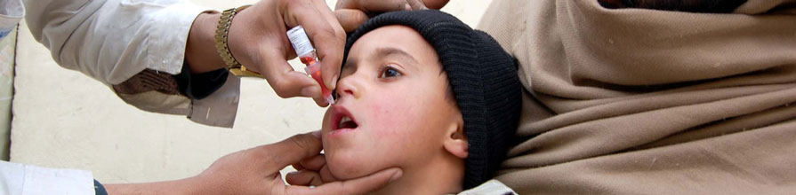Doctor administering vaccine to young child