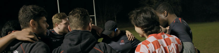 City Men's Rugby Team Huddle