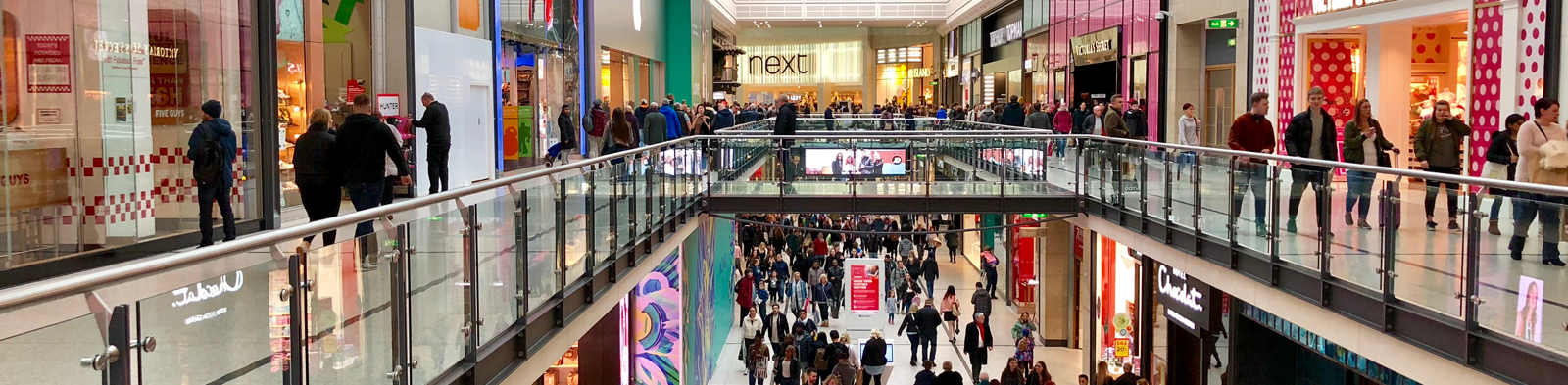 people walking around a crowded shopping centre
