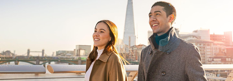 Male and female students on millennium bridge