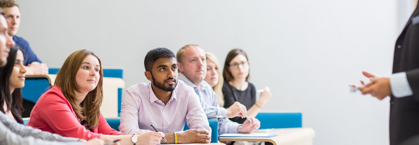 Staff sitting and listening in a lecture