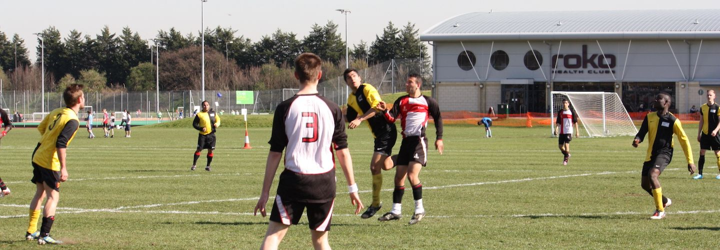 Male students playing football
