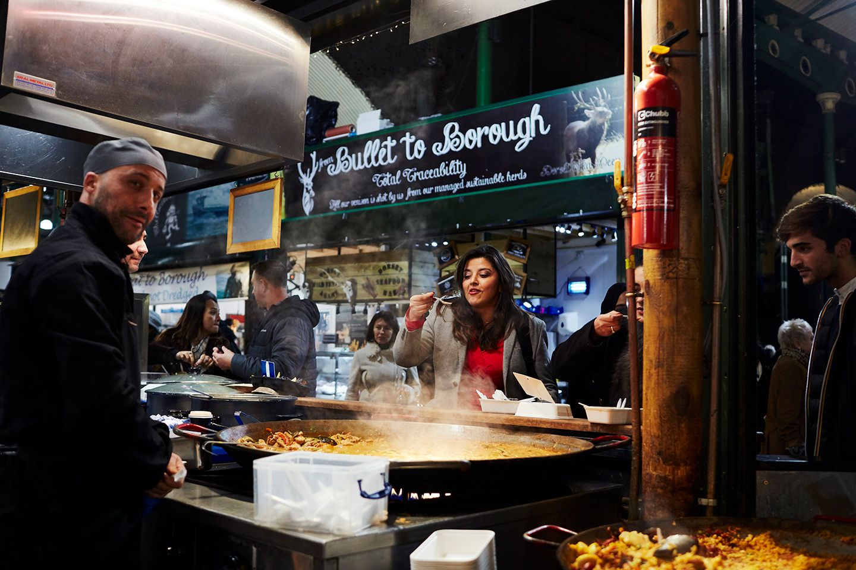 Female samples street food at Borough Market