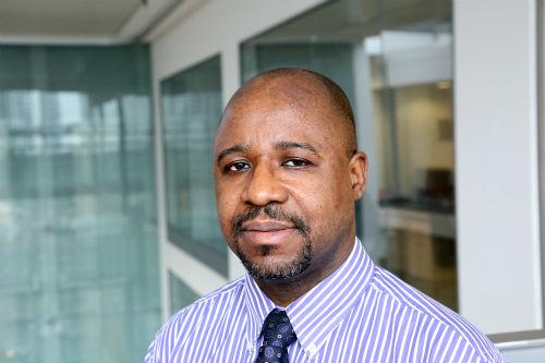 Adebayo Oluyinka Ogunjimi wearing a shirt and tie