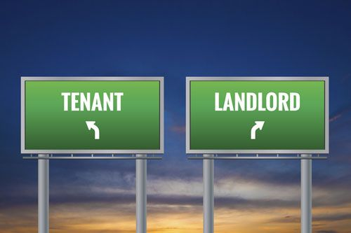 Two directional signs: Tenant and landlord