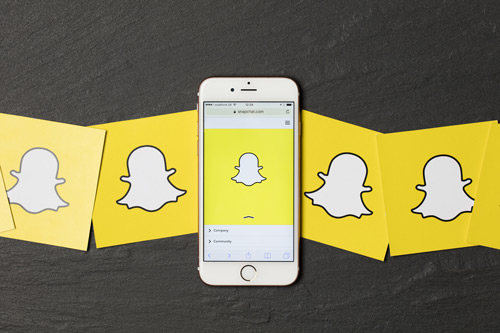 Snapchat logo on iPhone and images next to