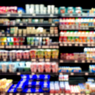 Blurry photo of supermarket shelves.