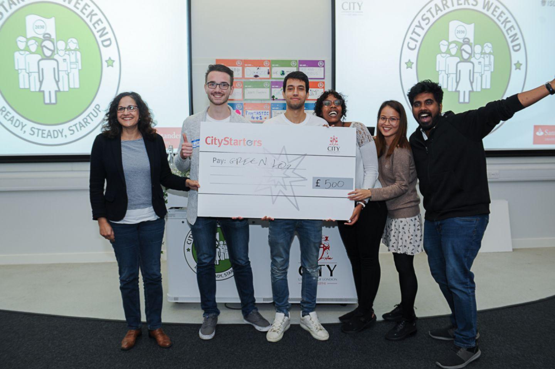 GreenLO2 team (Fabian Ronig, Mohamed Darwish, Darlene Kijemba, Miley Wei, and Lional Roy Sharon) holding their cheque presented by Cllr Asima Shaikh.