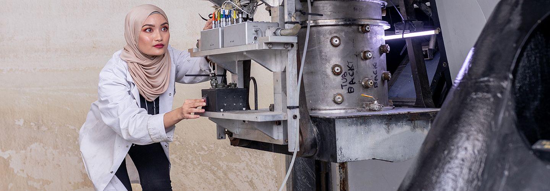 Student using the centrifuge
