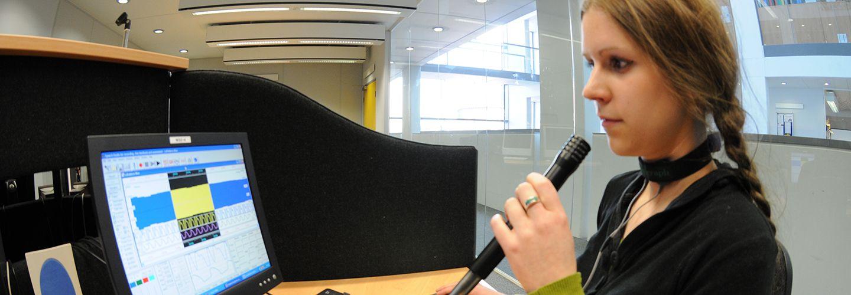 Student using the Phonetics Lab equipment