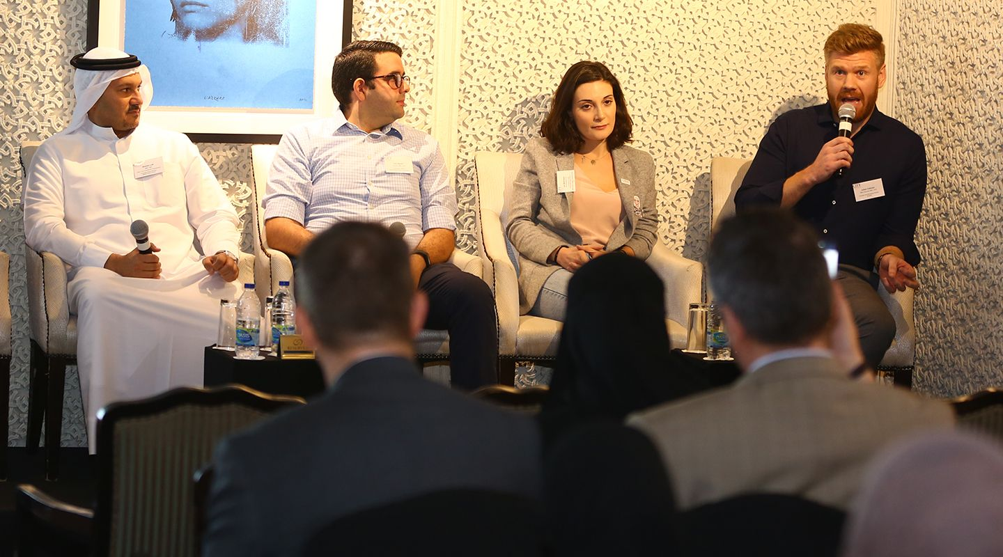 Alumni talking at a panel discussion