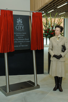 HRH The Princess Royal next to the commemorative plaque at the opening of the new City, University of London entrance at Northampton Square