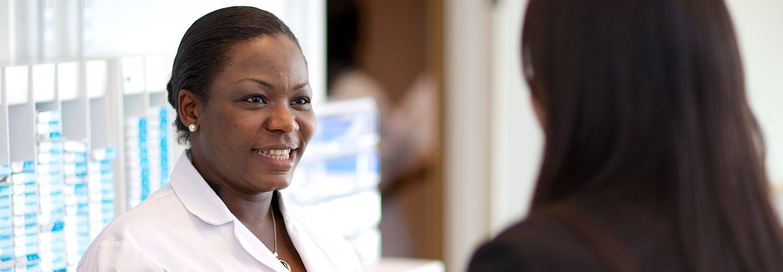 Female nurse smiling in a clinic