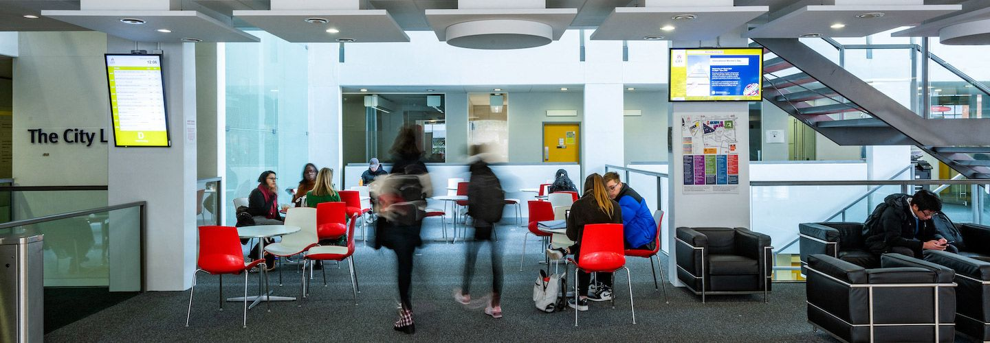 Students chatting in the seating area