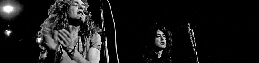 Led Zeppelin's Robert Plant on stage with a tambourine and Jimmy Page with a guitar