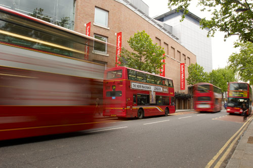 Sadlers Wells theatre obscured by red buses