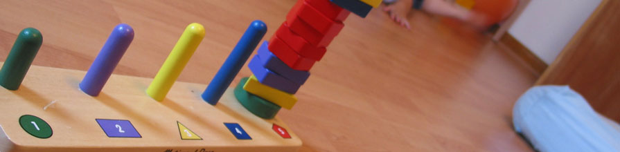 A child's wooden toy pictured where all different shaped blocks have been placed onto one shapes space
