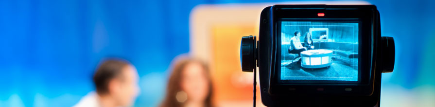 Focus on video camera viewfinder recording TV show