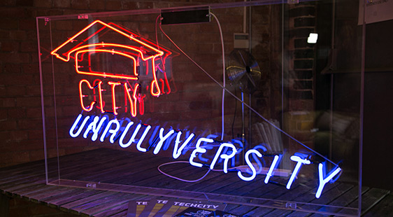 Unrulyuniversity written in neon lights