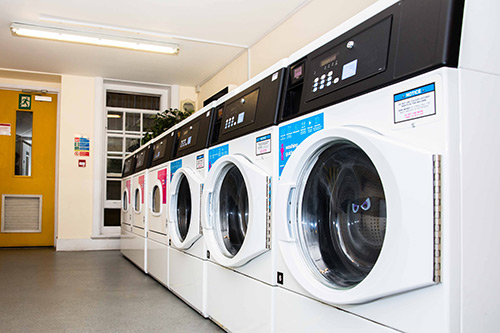 Laundry room at Alliance House - three washers and three dryers