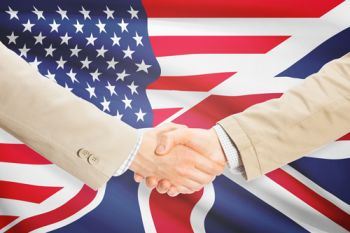 UK and US flags together with two hands shaking in front.