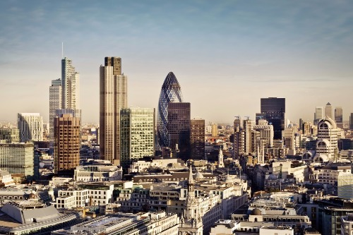 City of London financial district with Canary Wharf in background.