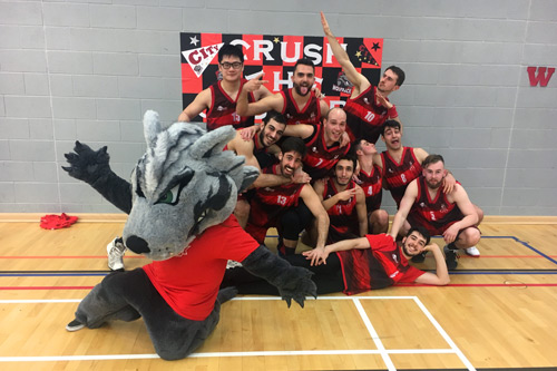 City varsity competitors with wolf mascot