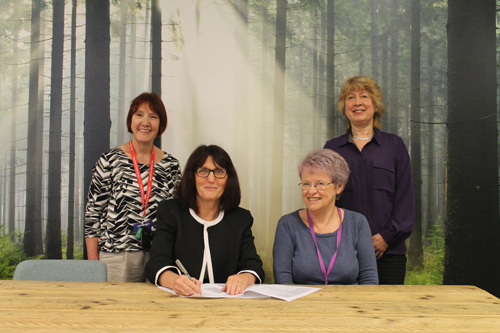 Professor Debra Salmon, Val Thurtle and Rosemary Marx along with another member of City staff signing off new baby friendly initiative.