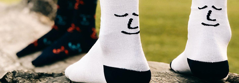 Two people wearing socks branded with Leiho logo