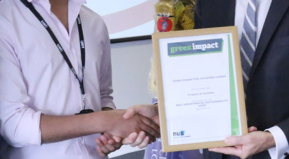 A Green Impact award being presented