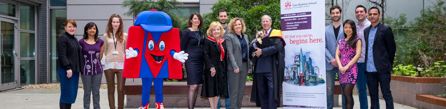 Vernon Hill celebrates his Honorary Visiting Professorship with wife Shirley, pet dog Duffy. He joined by Dr Sionade Robinson and Professor Marianne Lewis and students from the current MBA cohort of Cass Business School