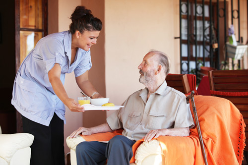 Nurse looks after an elderly patient