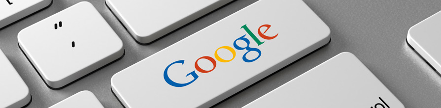 Google on keyboard. Journalist productivity