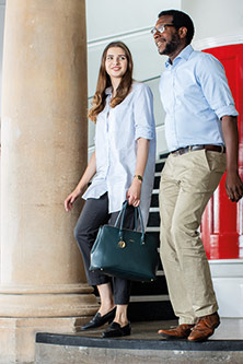 Two City students walking in the College Building