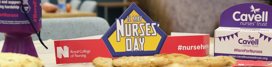 International Nurses Day 12 May sign amongst cakes