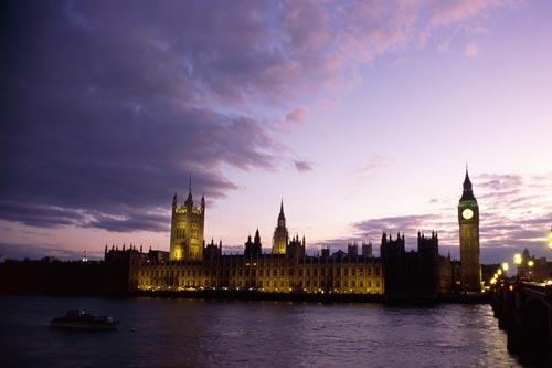 Westminster Palace beneath a purple sky