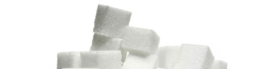 White sugar cubes are piled up